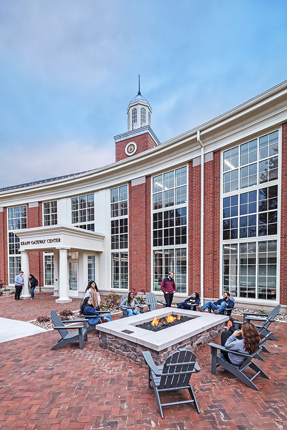 Outdoor seating, like this gathering area with a fire pit at Lycoming College Krapf Gateway Center, may need to increase to accommodate social distancing.