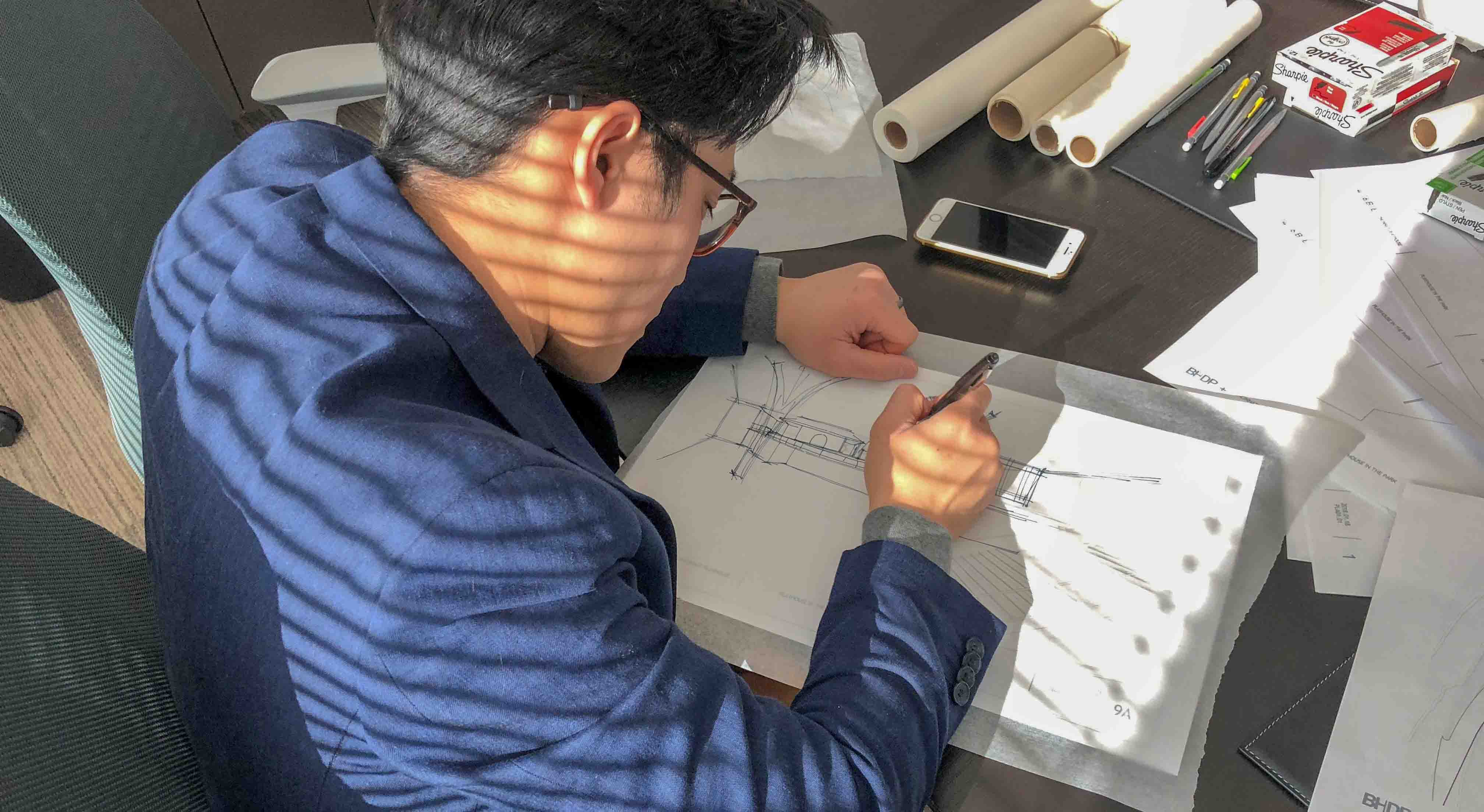 Minh Vu sketching on paper