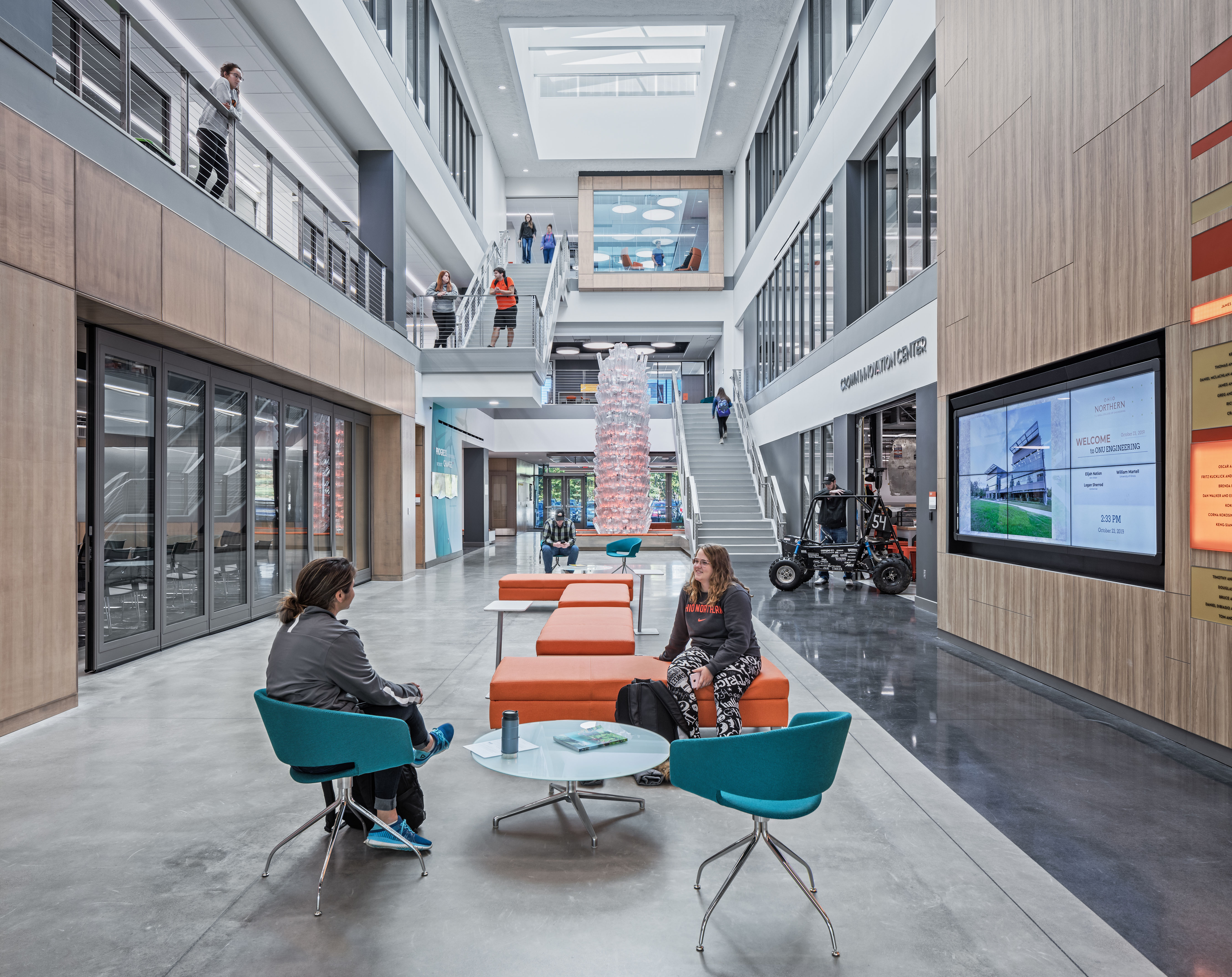 Students collaborate inside the atrium