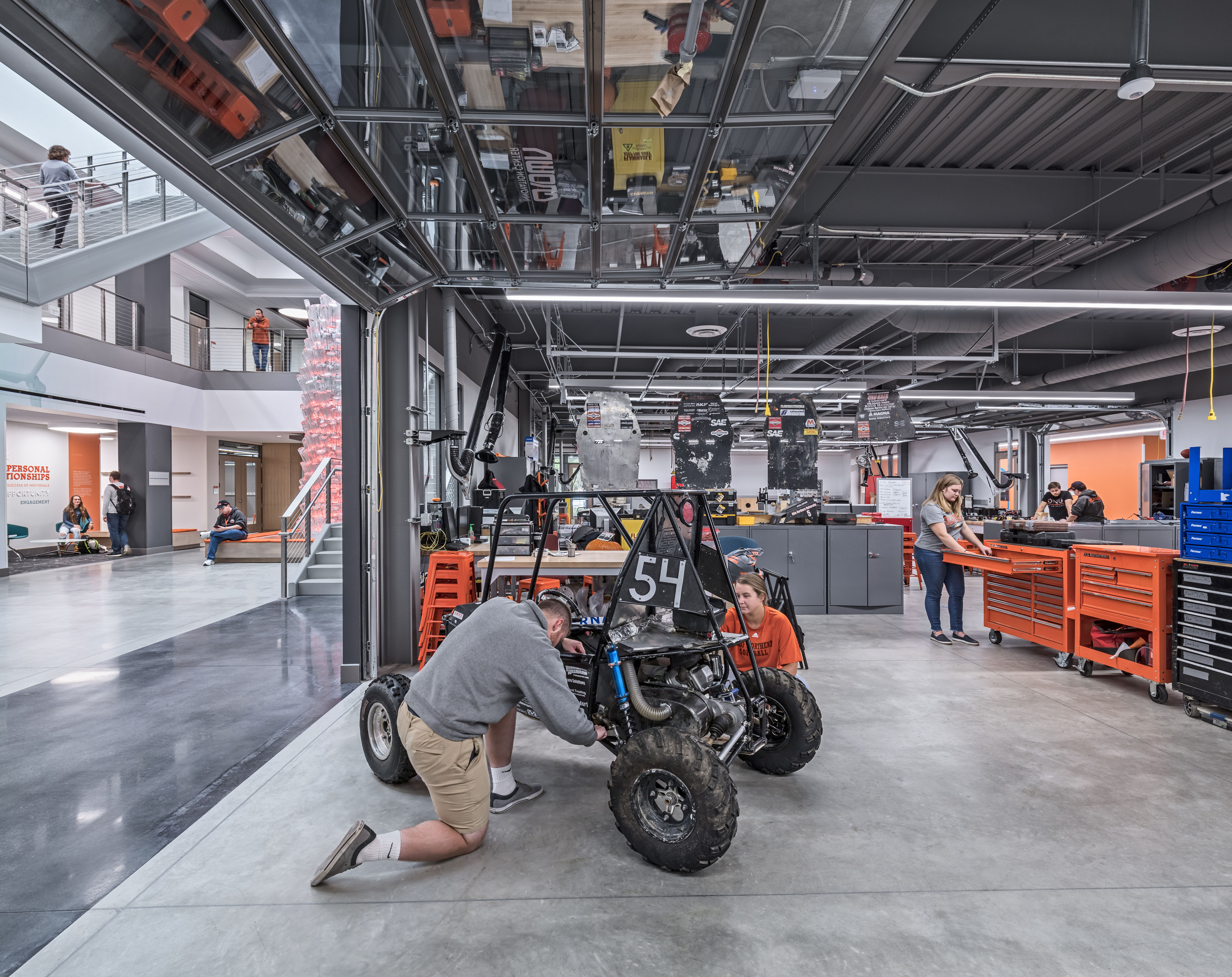 Moveable garage doors inside student studios allow visibility into the atrium