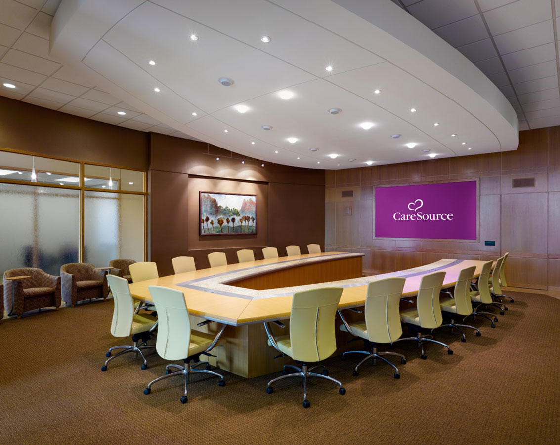 A conference room with a u-shaped table