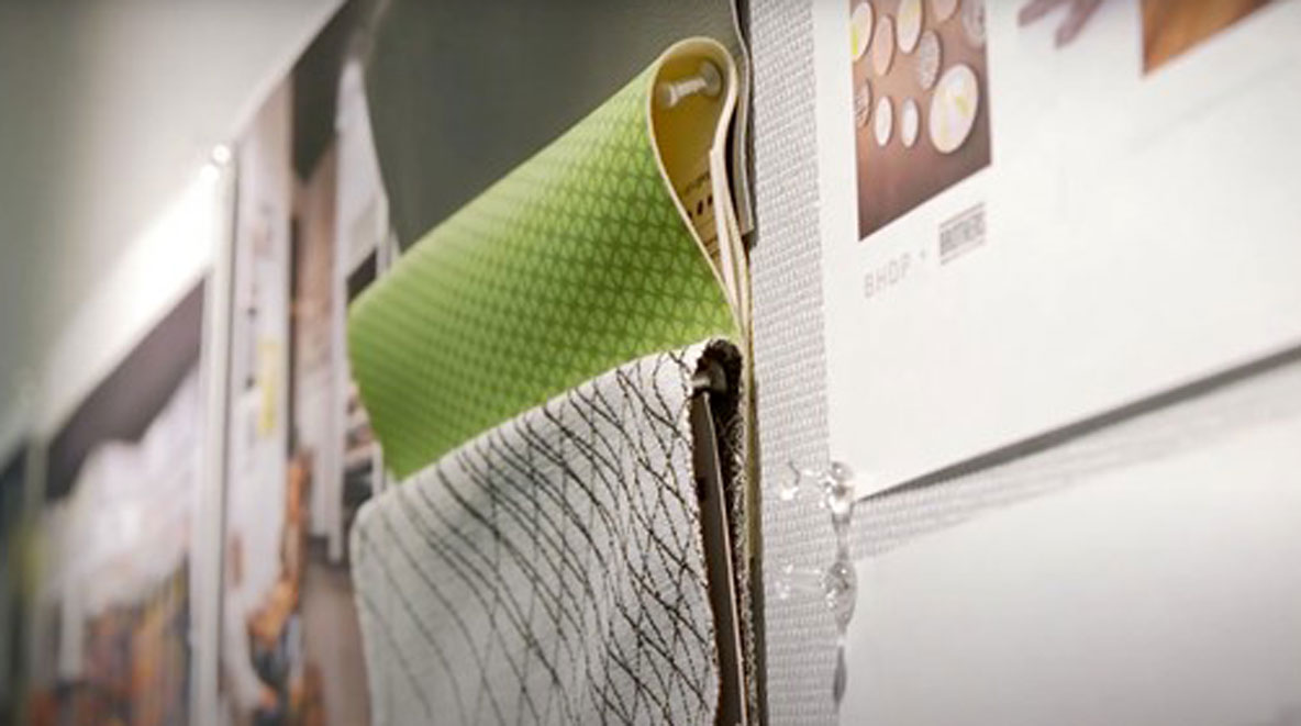 Fabric samples tacked to the wall