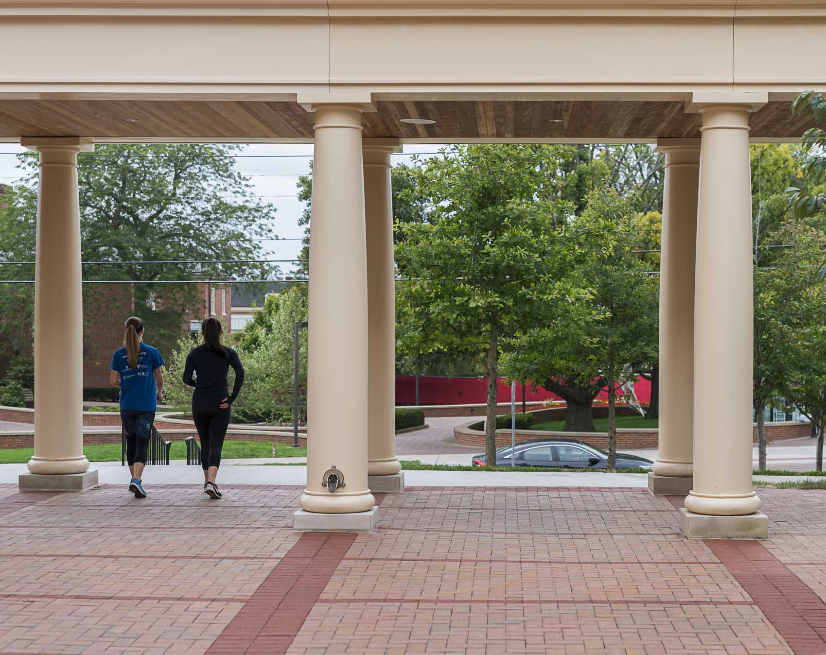 Two students walking under awning at Miami University