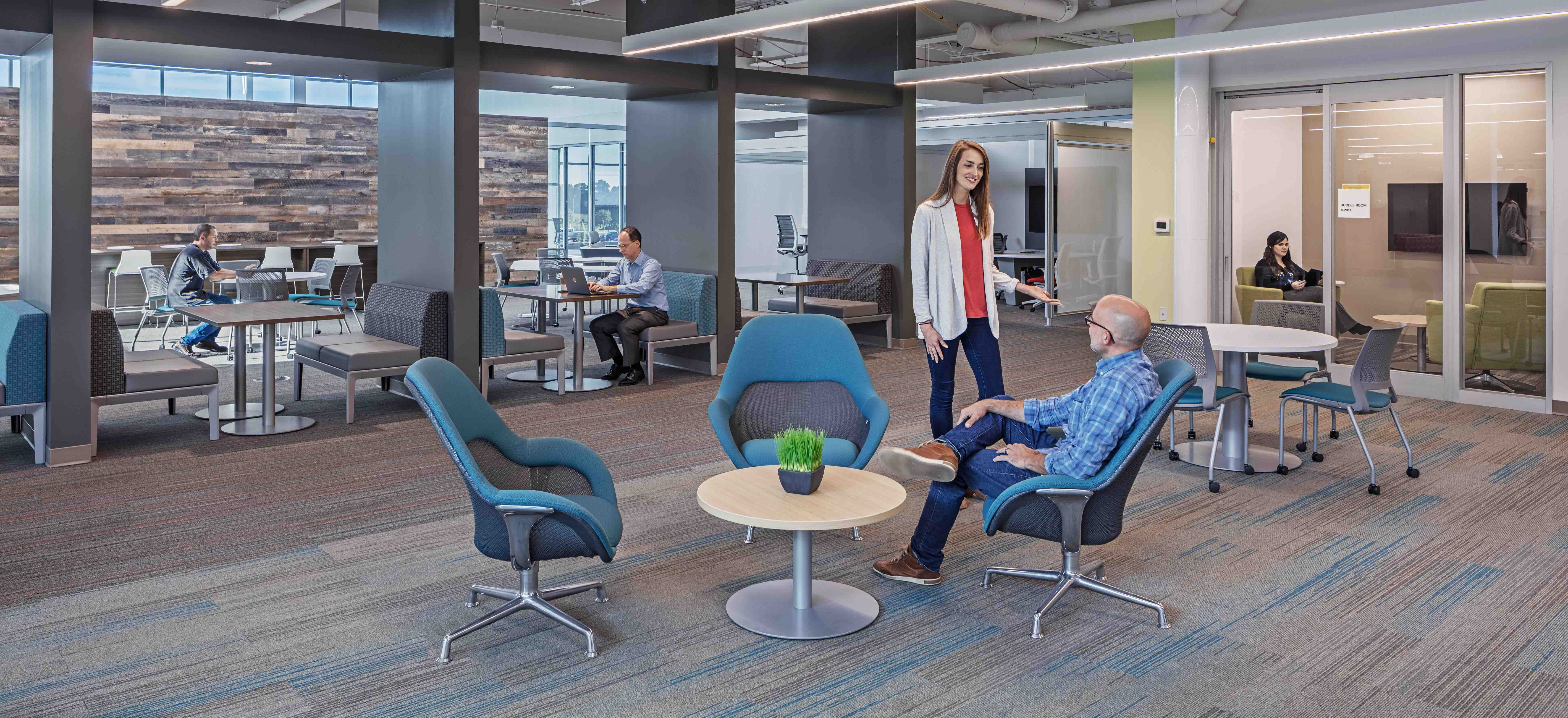 People converse in the Toyota Georgetown Production Facility office space
