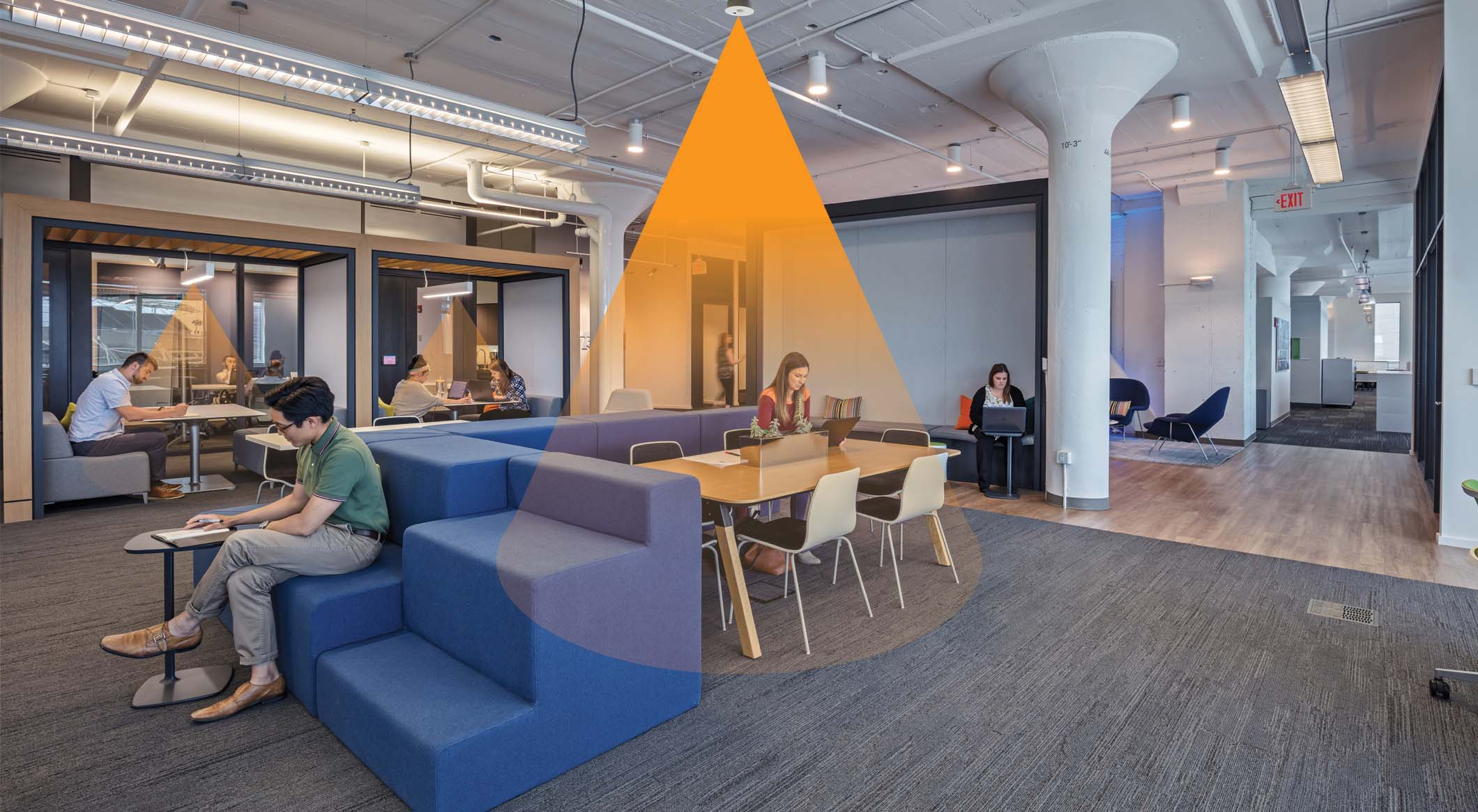 People sit in a common area with orange rays drawn to illustrate sensors