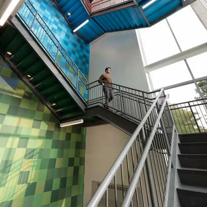 Man walking down stairs at Altria HQ