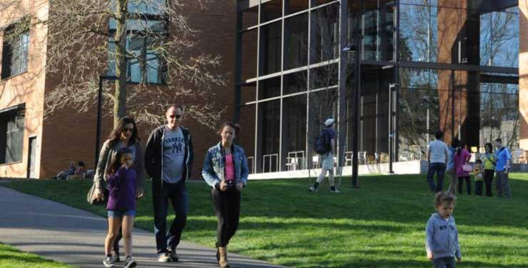 family walking on college campus