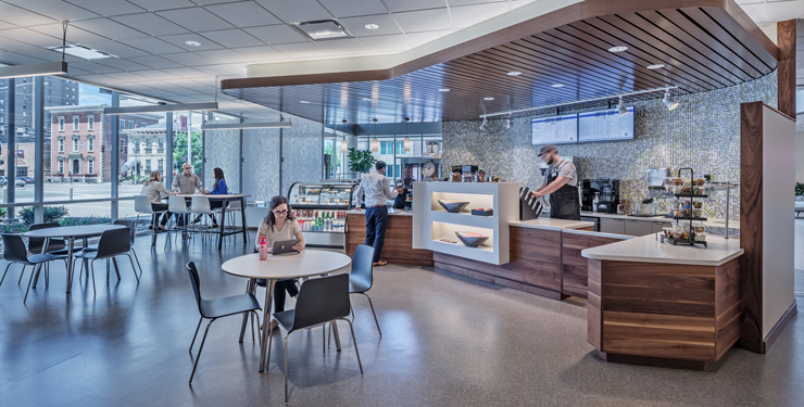 Employees grab coffee at the café inside CareSource