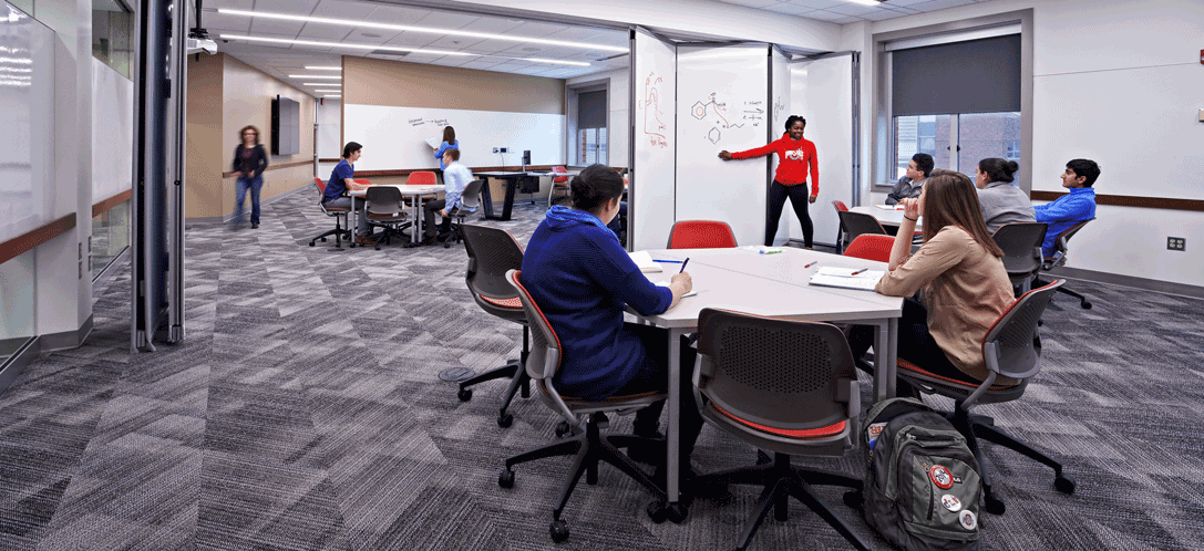 Students gather in the OSU Research Commons to complete a school project