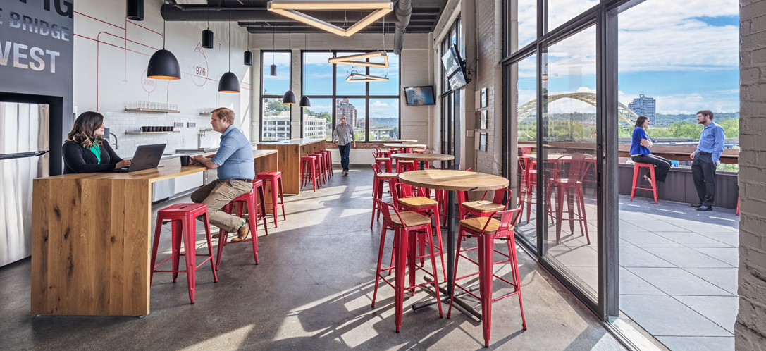 Employees congregate in the kitchen and outdoor space at Schaefer