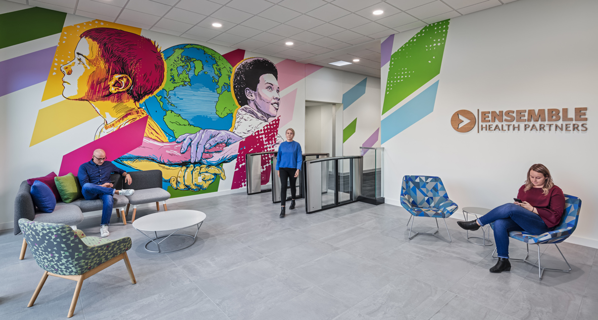 The guest entrance features a colorful mural