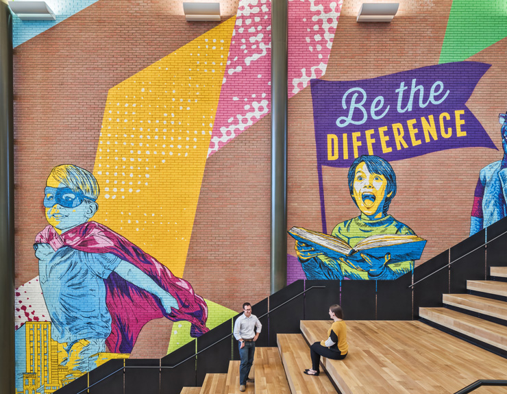 Murals are shown beside the staircase