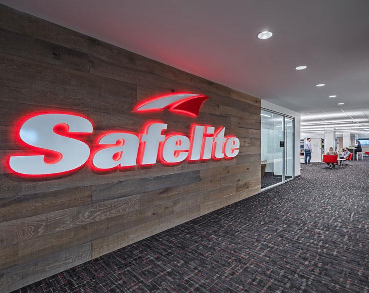 Safelite logo on wood wall