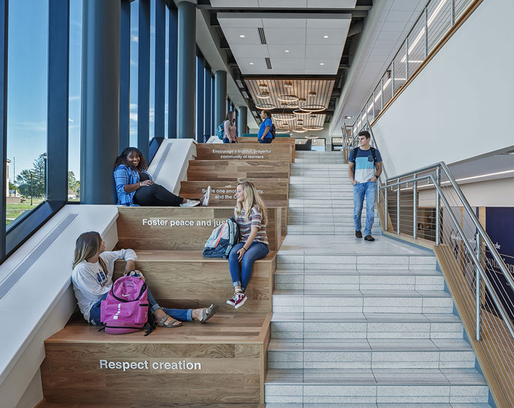 Students gather on the large feature stair
