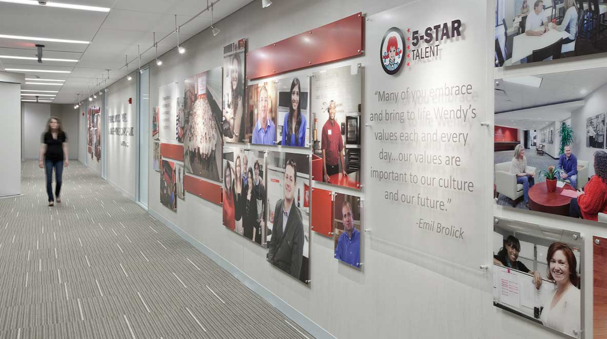 A wall filled with Wendy's photos and a statement about the company's 5-star talent
