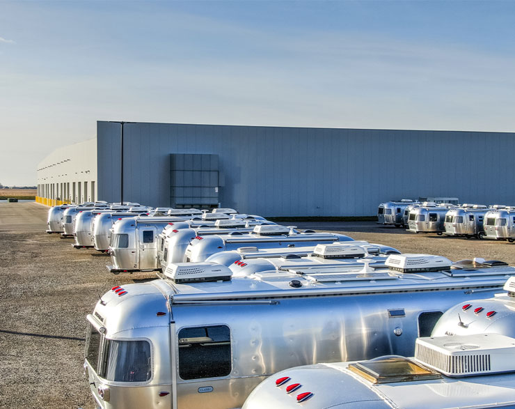 Airstreams lined up behind the facility