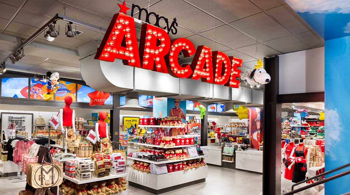 """""""Macy's Arcade"""" shines in big red letters above merchandise"""