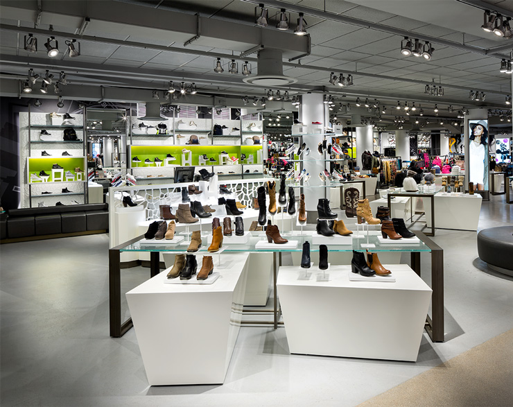 A shoe display with hints of green accents