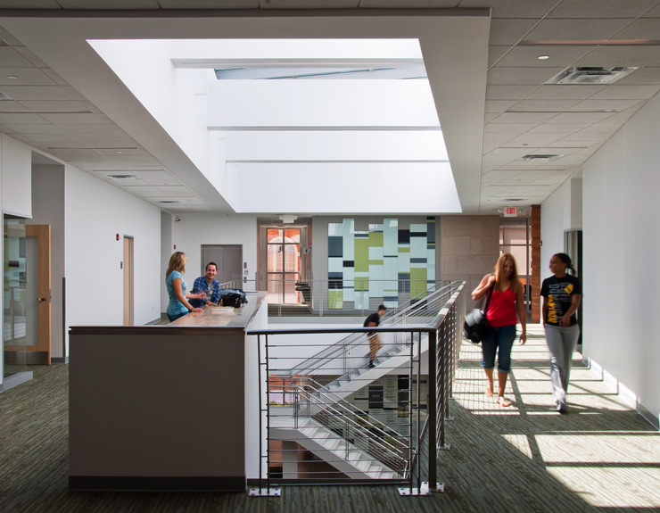 Above the staircase, there is a light-filled atrium