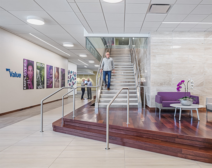 An employee comes down the grand stair