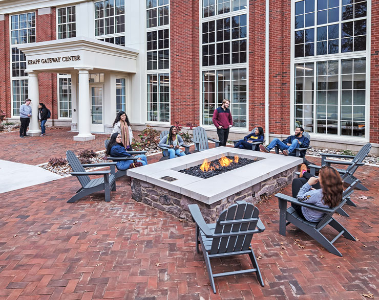Students gather around a firepit