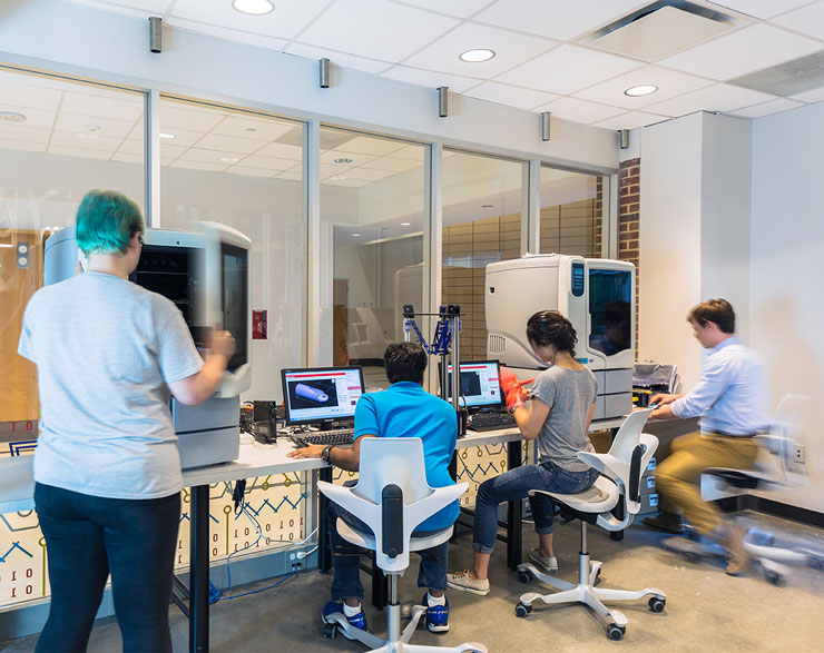 Students work together in a lab using imaging equipment