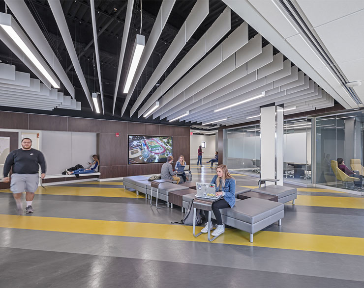 Students take advantage of the open work area with different nooks and huddle rooms