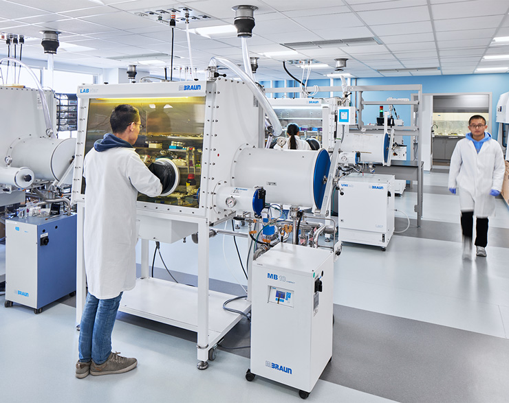 A student has their hands inside a machine