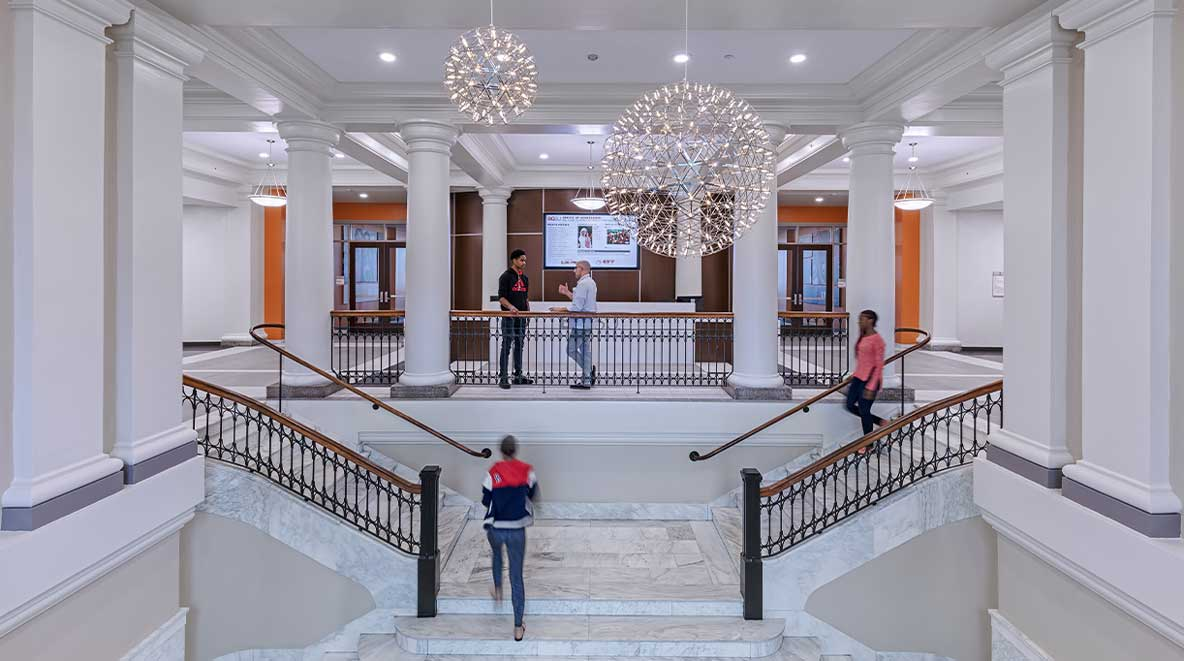 Students travel up the grand stair