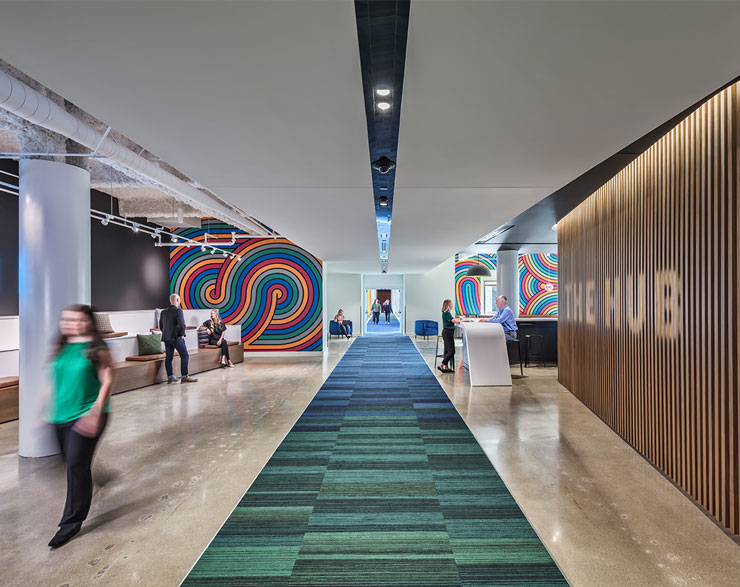 A hallway separates the promotions space and the hub