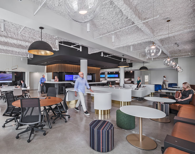Employees interact in the hub