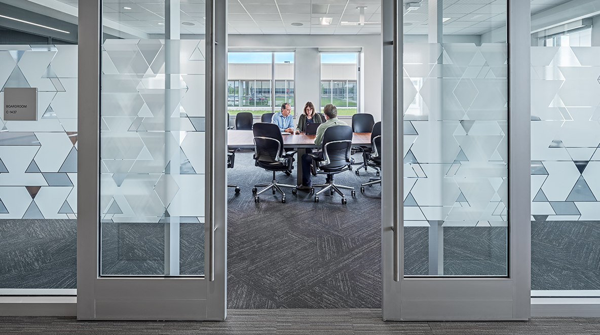 The new boardroom provides space for formal meetings, and privacy vinyl provides seclusion.