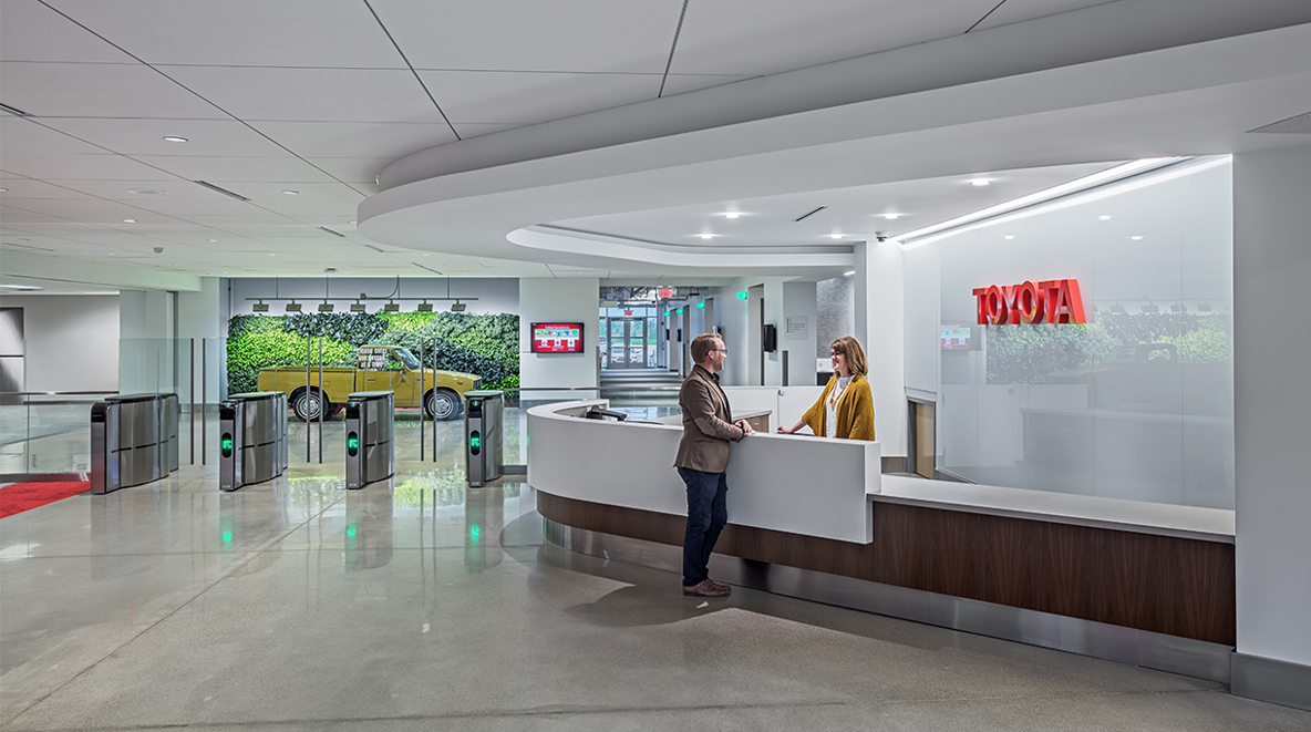 An employee stands in the lobby at Toyota York
