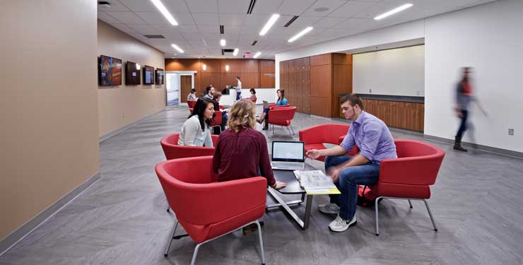 Students work together inside the research commons